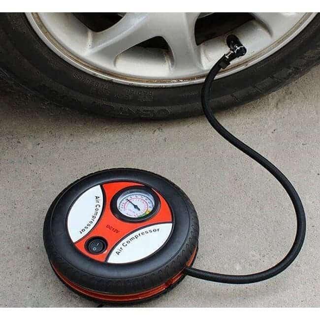 Tire pump with pressure gauge